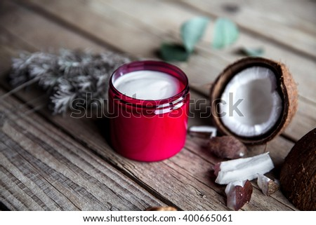 natural, organic cream on wooden background. Care beautiful and healthy skin. Beauty and health.Lavender and coconut.