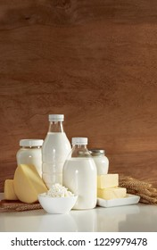 Natural organic dairy products such as milk, butter, yogurt, cheese, cottage cheese, cream and kefir, front view composition