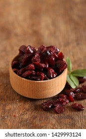 natural organic dried cranberries on a wooden table
