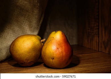Natural organic farm grown pears in traditional vintage style composition artistic photograph style classic still life