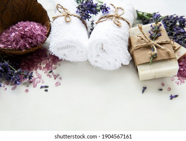 Natural organic SPA cosmetic with lavender. Flat lay bath salt, spa products and lavender flowers on wooden background. Skin care, beauty treatment concept
