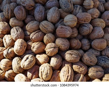 Natural organic walnut pecan nuts arranged for sale display in a market shop