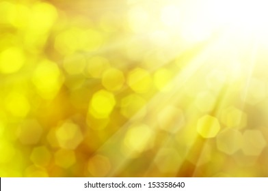 Natural outdoors bokeh  in golden autumn tones with sun rays
