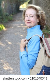 Natural outdoorsy 65 years old woman