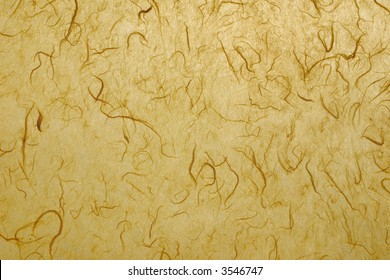 Natural paper background in yellow with fibers