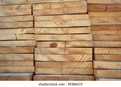 Natural patterns created by wooden boards stack viewed from the end
