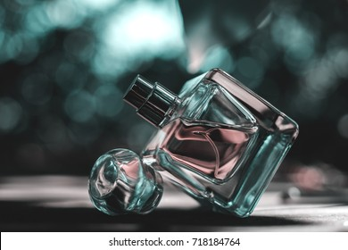 Natural perfume  bottle on blurred background