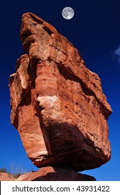 The natural phenomenon of Balanced Rock at the Garden of the Gods near Colorado Springs, Colorado with moon