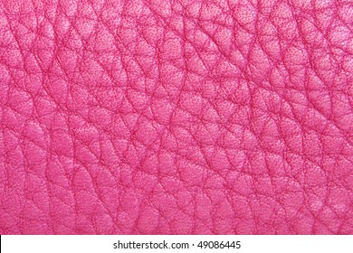Natural pink leather background closeup