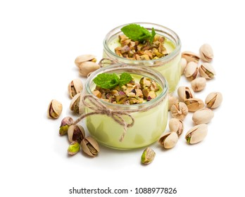 Natural  pistachio yogurt in a small glass jar isolated on white