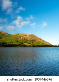 A natural pond or water catchment in the Caribbean