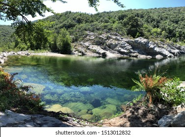 A natural pool in the forest and mountains of Corsica, France