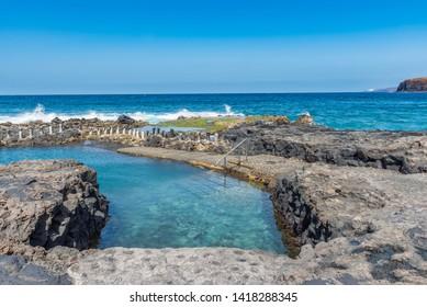 Natural pool Las Salinas de Agaete in Puerto de Las Nieves, Gran Canaria, Spain. Copy space for text