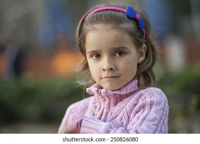 Natural portrait of a happy pretty little girl