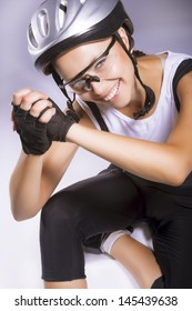 natural portrait of professional female caucasian bike athlete sitting and showing brilliant smile. vertical image