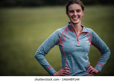 Natural portrait of young happy woman who is full of endorphines thanks to a good roller blade workout. Sporty woman wearing long sleeve merino wool functional t-shirt.