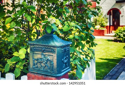 natural post box in garden