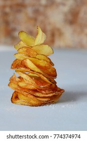 Natural potato chips with sea salt on a light background