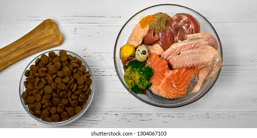 Natural raw dog food BARF diet as opposite of kibble dry food Concept Closeup