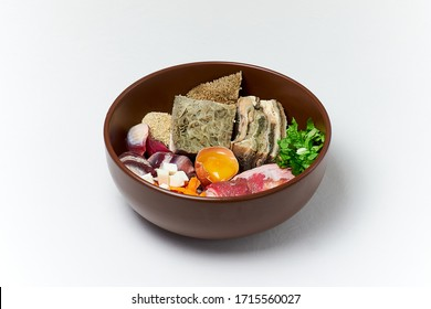 Natural raw dog food in bowl. Natural meat products vegetables egg vitamins and supplements. Organic pet food. Close up