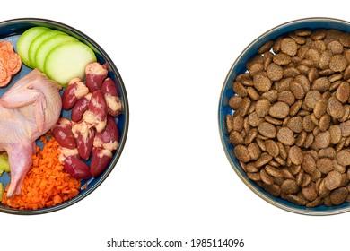 Natural raw dog food and kibble in bowls. Natural dog food versus kibble.