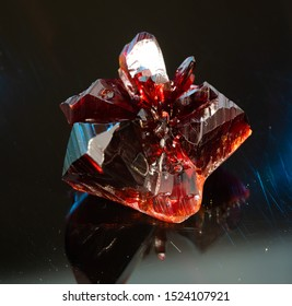 Natural raw red crystal. Natural red precious mineral stone