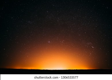 Natural Real Night Sky Stars Background. Sunset, Sunrise Over Field