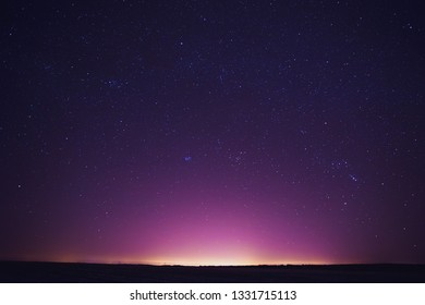Natural Real Night Sky Stars Background Texture. Sunset, Sunrise Over Field