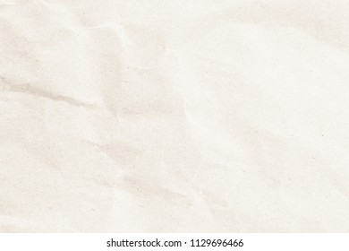 Natural recycled paper or paperwork closeup of wrinkle texture shiny work sheet. Have art light tone brown adorn.