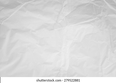 Natural recycled paper or paperwork closeup newspaper of wrinkle texture shiny work sheet. Have art light tone grey and white adorn wallpaper copy space.