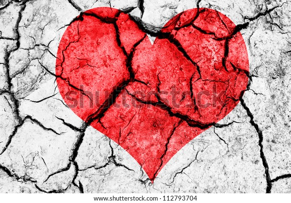natural red heart shape in cracked dry soil