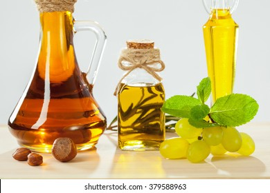 Natural remedies for strong hair and shiny skin. Composition of natural oils, nuts, mint leaves and grapes