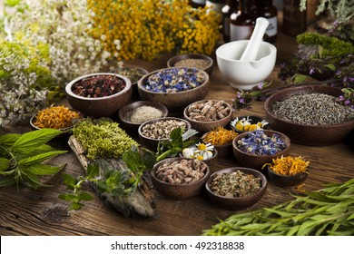 Natural remedy and mortar, healing herbs background