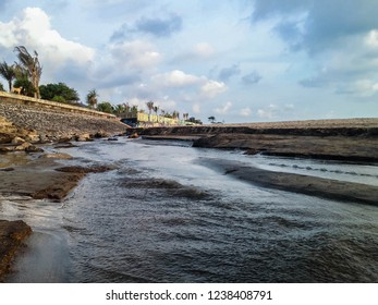 Natural River Beach Water Flow Scenery At Batu Bolong Beach, Canggu Village, Badung, Bali, Indonesia