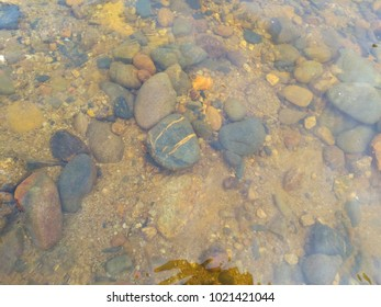 Natural river stone inside a clear river water in Sg Lembing, Malaysia.