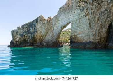 The natural rock arch and crystal sea waters near Zakynthos Island, Greece.