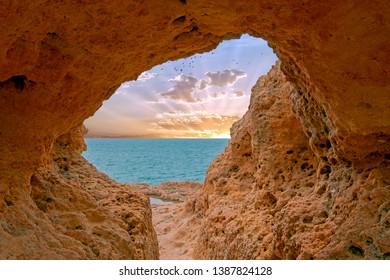 Natural rocks at Algar Seco in Carvoeiro Algarve Portugal at sunset