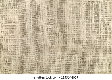 Natural rough beige burlap texture background, top view