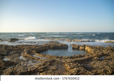 Natural round hole in the riffs of Mediterranean sea
