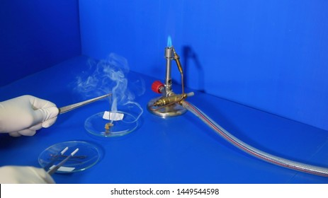 Natural rubber testing (NR), CR, NBR, SBR, SR, with heating using copper rods burned hotly in a fume hood in a chemical science laboratory.