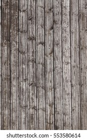 Natural Rustic Wooden Wall Plank Vertical Barn Wood Texture. Shabby Grey Gray Exterior Background. Interior Wood Paneling Brown Surface. Barnwood Vintage Structure. Faded Aged Paint Wood Wall