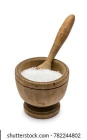 natural salt into wooden pestle, on white background