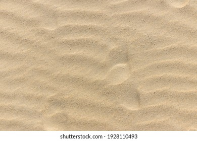 Natural sand stone texture background. sand on the beach as background. Wavy sand background for summer designs.