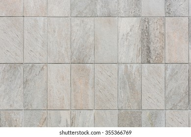 natural sand stone tile wall seamless background and texture