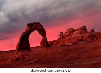 Natural sandstone arch at sunset. Delicate Arch in Arches National Park near Moab. Utah. The United States of America.