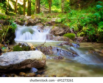 Natural scene of Milky white waterfalls with green surrounding