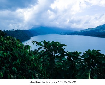 Natural Scenery Cloudy Atmosphere On Mountains Lake Buyan At Wanagiri Village, North Bali, Indonesia