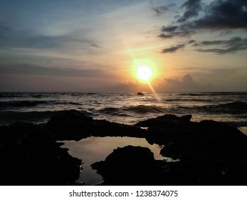 Natural Scenery Of Sunset View On The Sea Rocks At Batu Bolong Beach, Canggu Village, Badung, Bali, Indonesia