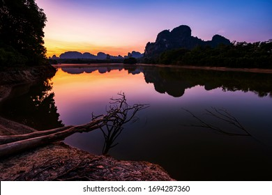 Natural Scenic landscape of beautiful Limestone mountains at dawn with twilight sky and reflection on water pond, Nong Talay, Krabi, Thailand. Famous travel destination in Thai southern.