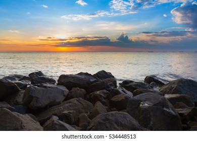 Natural sea rock over the beach with beautiful sky after sunset, natural landscape background